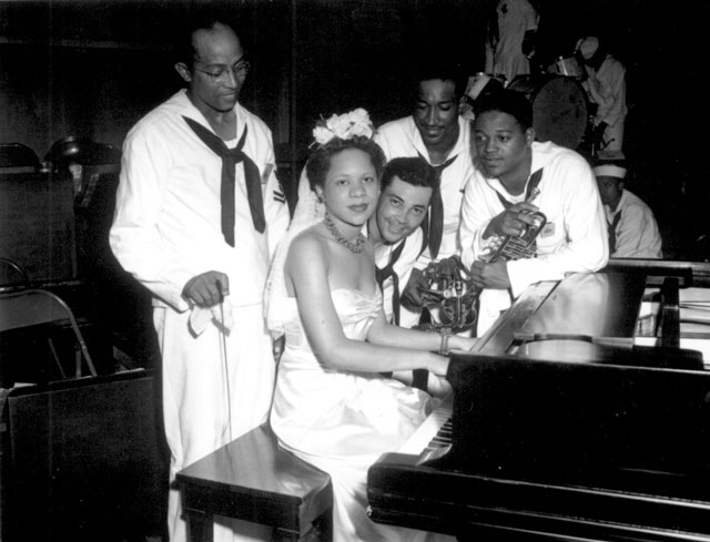 Dorothy Donegan, pianist, and Camp Robert Smalls swing band at NTS, Great Lakes. June 16, 1943. 80-G-29490