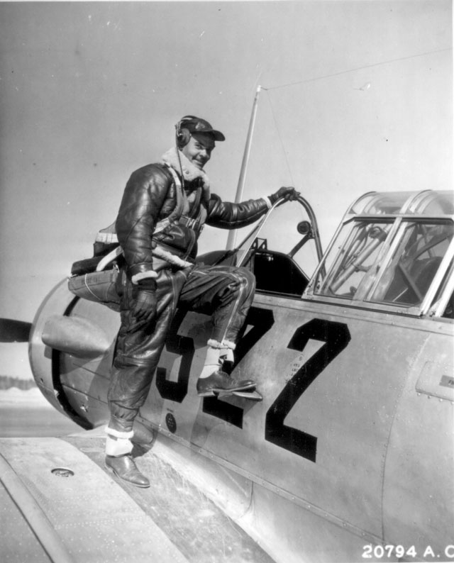 Capt. Benjamin Oliver Davis, Jr., of Washington, D.C., climbing into an Advanced Trainer. Tuskegee, Alabama. January 1942. Wilfred Morgan. 208-FS-872-3.