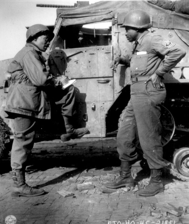 War Correspondent Ted Stanford of The Pittsburgh Courier, a weekly, interviews 1st Sgt. Morris O. Harris, a tankman of the 784th Tank Battalion operating with the Ninth Army. March 28, 1945. 208-AA-32P-14.