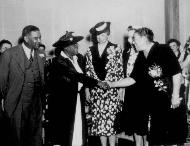 [Mary McLeod Bethune], Mrs. Eleanor Roosevelt and others at the opening of Midway Hall, one of two residence  halls built by the Public Buildings Administration of FWA for Negro government girls  Washington, DC.  May 1943. James Stephen Wright. 162-PBA-10-F-561.