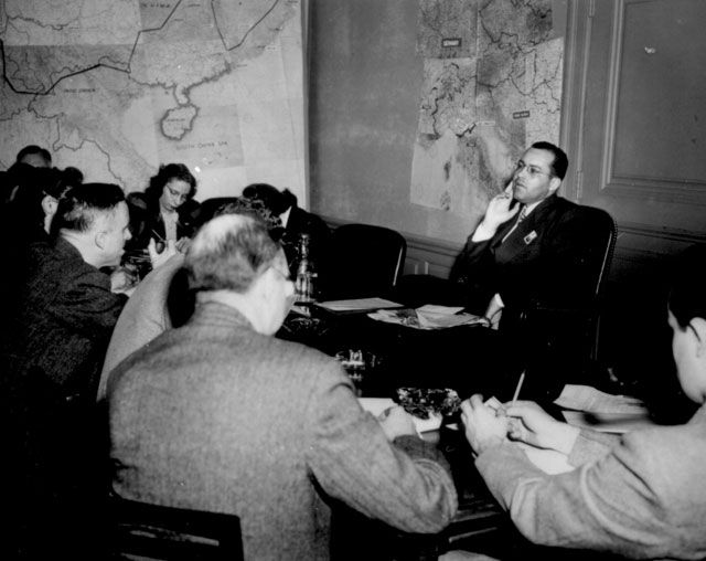 Mr. Truman K. Gibson, Jr., Civilian Aide to the Secretary of War, pictured at press conference Monday, April 9,  following his return from Mediterranean and European Theaters of Operations.  April 9, 1945. 208-PU-77F-5.