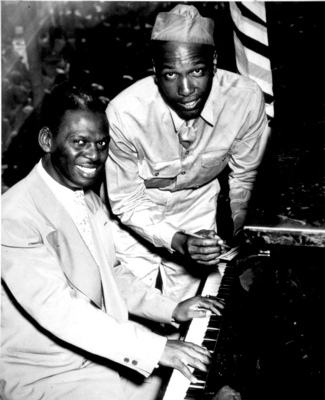 Earl 'Father' [Fatha] Hines, a great swing musician, is shown with Pvt. Charles Carpenter, former manager of  the Hines orchestra  Camp Lee, VA. N.d. 208-NP-5XX-9.