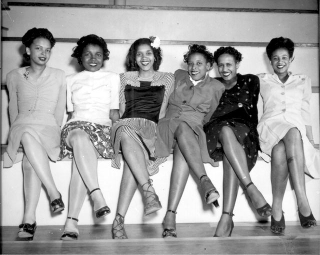 Pin-up girls at NAS Seattle, Spring Formal Dance. Left to right: Jeanne McIver, Harriet Berry, Muriel Alberti,  Nancy Grant, Maleina Bagley, and Matti Ethridge. April 10, 1944. 80-G-23326.